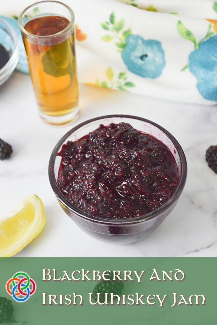 Blackberry jam beside a lemon wedge and whiskey shot