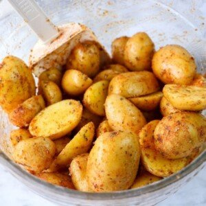 Potatoes seasoned in a bowl