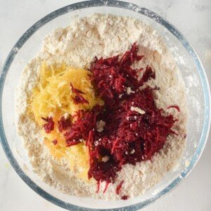 Grated beetroot and pumpkin with flour in a bowl