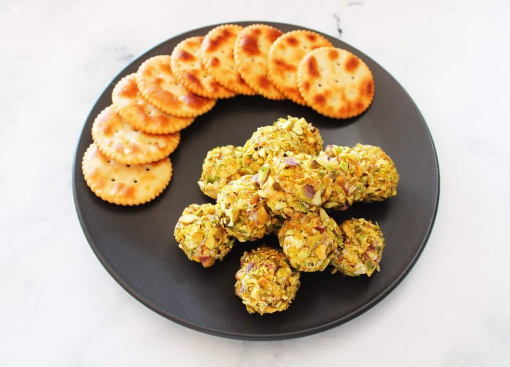 Savory appetizer balls with crackers on a plate