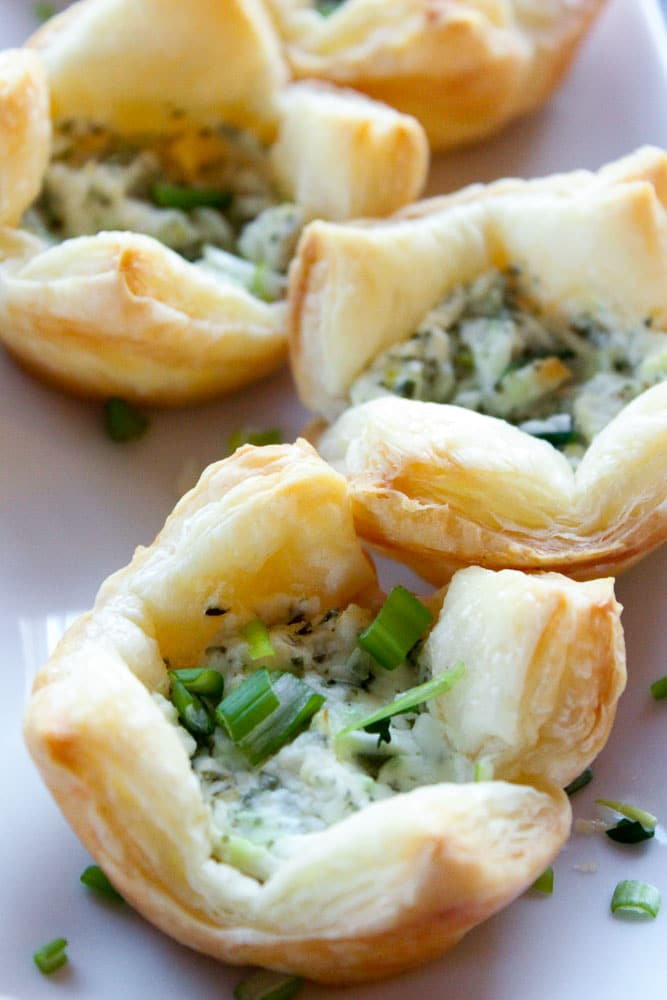 Puff pastry appetizers with green savory filling