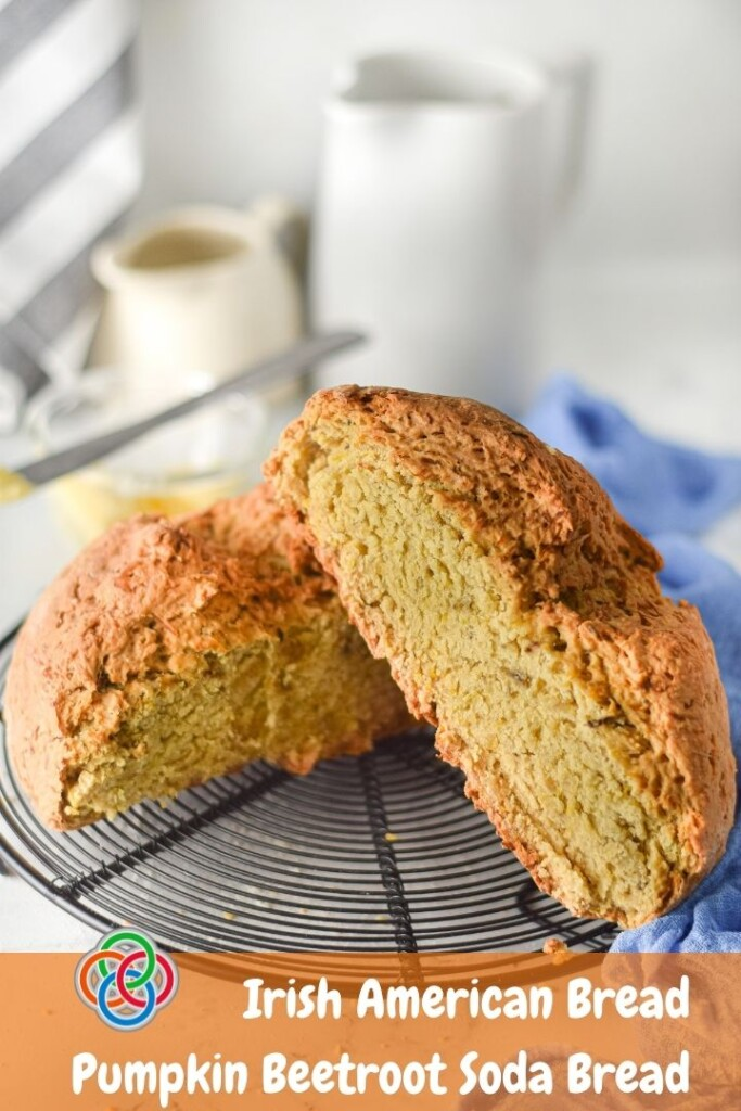 Pumpkin soda bread cut in two halves on a wire rack with a text banner