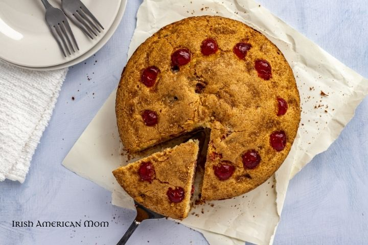 A slice being cut from a cherry cake