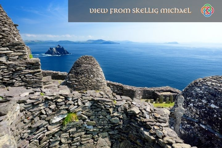 Stone huts and walls beside the ocean with a text banner